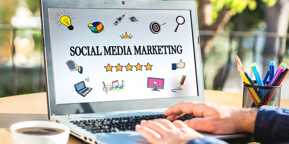 Social Media Marketing Concept On Laptop Screen With Various Doo